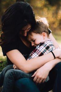 woman hugging young boy
